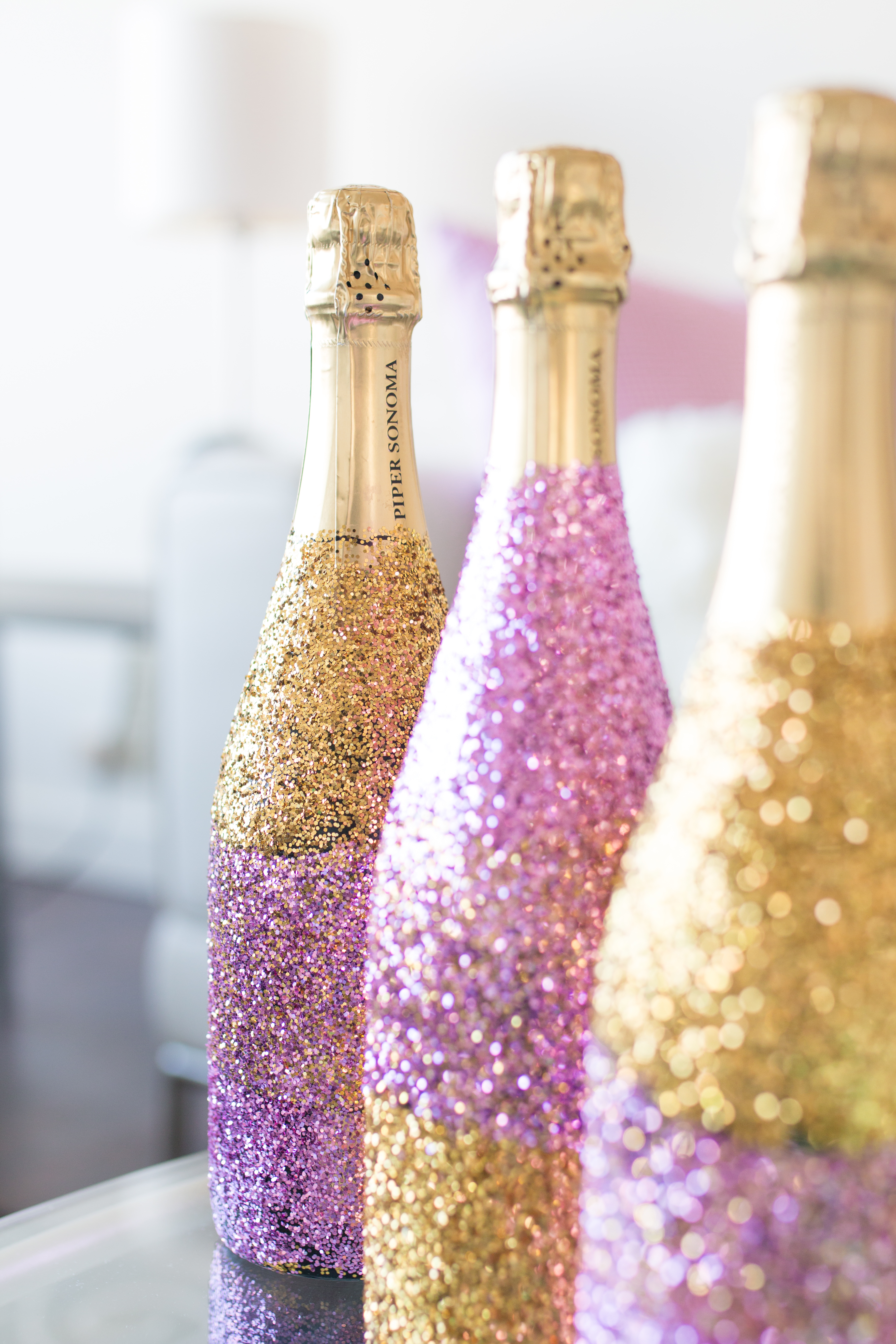 Diy glitter ombr champagne bottle baubles to bubbles for How to make glitter wine bottles